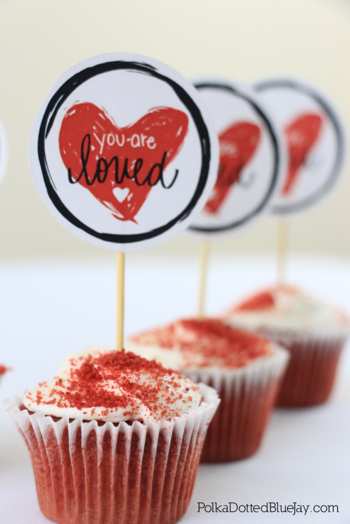 "This ""You Are Loved"" hand lettered printable is perfect for Valentine's Day. It makes a great Valentine's Day cupcake topper!"