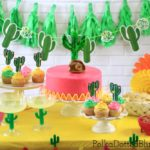 This fun and festive Cinco de Mayo Party tablescape is full of pink, yellow, and green decorations. Click through to see the whole party and a list of what you will need to throw your own Cinco de Mayo fiesta!