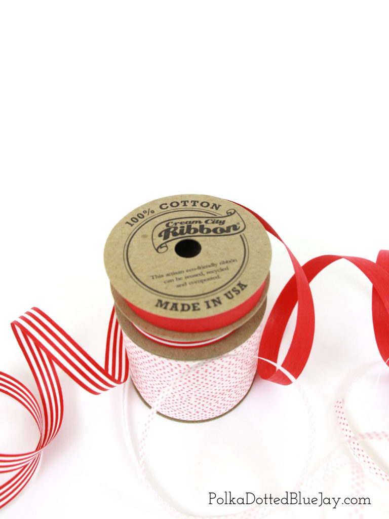 Candy Cane Gift Wrap Ideas for Christmas presents. Simple kraft paper and Cream City Ribbon are a great candy cane theme for Christmas presents.